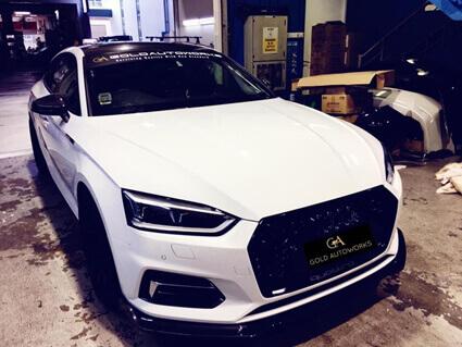 A smooth white car inside a car garage